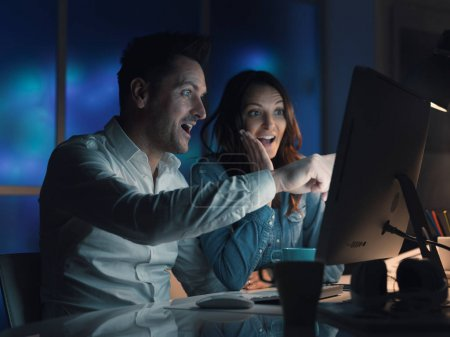 Happy couple connecting online together