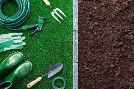 Photo for Gardening tools on the grass and fertile humus soil; gardening and agriculture concept, top view - Royalty Free Image