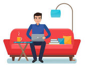 Freelancer man with computer on sofa at home