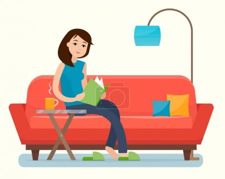 Young woman reading book on sofa at home.
