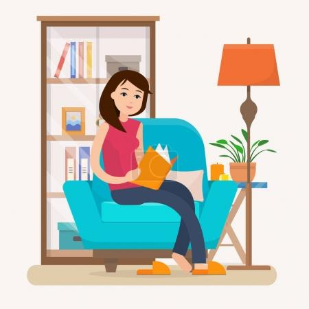 Young woman reading book on chair at home.