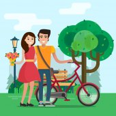 Man and woman on a date in park with flowers and bike