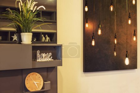 Photo for Interior Design Details. Big Picture on the wall in living room, art photo of light bulb - Royalty Free Image
