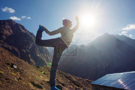 Traveler Yoga Woman doing exercise in Himalaya