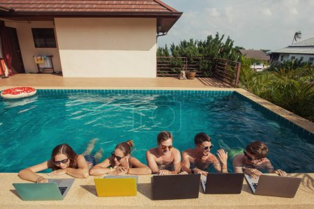 Group of people freelancers using laptops computer...