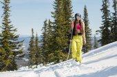 female snowboarder  walking in winter
