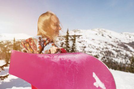 snowboarder woman standing with snowboard