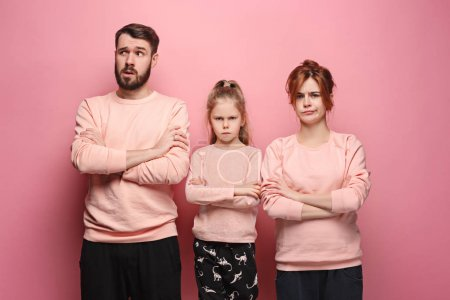 The sad family on pink