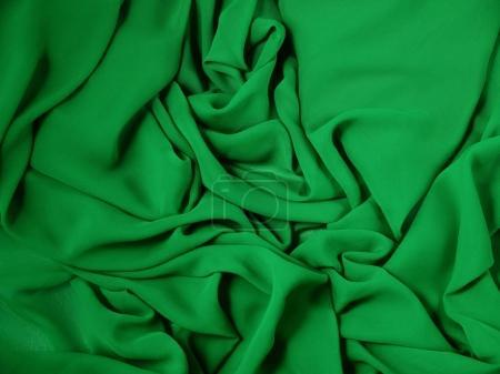 Photo pour Le tissu rouge vert, fond et texture de tissu, théâtre rideau - image libre de droit