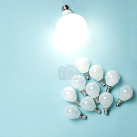 Photo for One light bulb outstanding, glowing different. Business creativity idea concepts. Flat lay design - Royalty Free Image