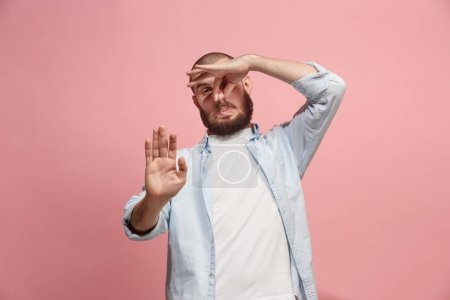 Photo for Ew. Its so gross. Young man with disgusted expression repulsing something. Disgust concept. Young emotional man. Human emotions, facial expression concept. Studio. Isolated on trendy pink color - Royalty Free Image
