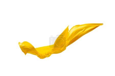 Photo pour Lisse élégant tissu jaune transparent isolé ou séparé sur fond de studio blanc. Texture du tissu volant . - image libre de droit