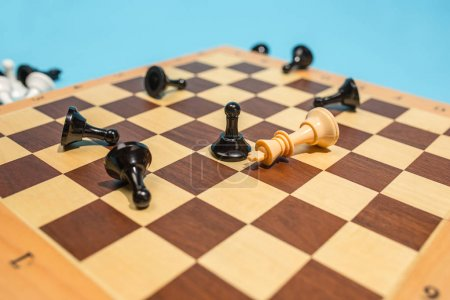 Photo for Last chance. Chess board and game concept. Business ideas, competition, strategy and new ideas concept. Chess figures on blue background. Selective focus. Side view. Win, victory, winner concepts - Royalty Free Image