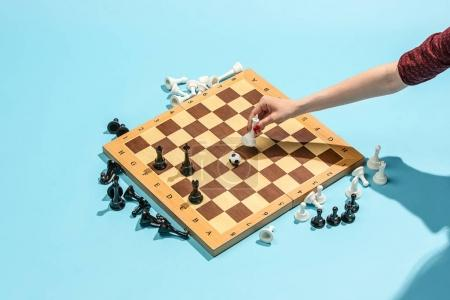 Photo for Soccer ball of chess pieces on the board. Game concept. Business ideas, competition, strategy and new ideas concept. Chess figures on blue background. Selective focus. Side view. Win, victory, winner - Royalty Free Image
