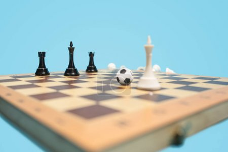 Photo for Football stratrgy. Soccer ball of chess pieces on the board. Game concept. Business ideas, competition, strategy and new ideas concept. Selective focus. Side view. Win, victory, winner concepts - Royalty Free Image