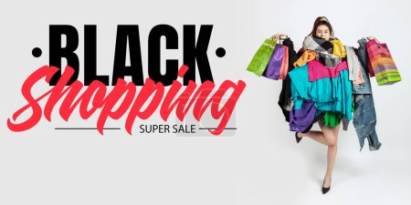 Photo for Black shopping, finance concept. Woman addicted of sales and clothes. Female model wearing too much colorful clothes. Fashion, style, black friday, sale, purchases, money, online buying. Flyer for ad. - Royalty Free Image
