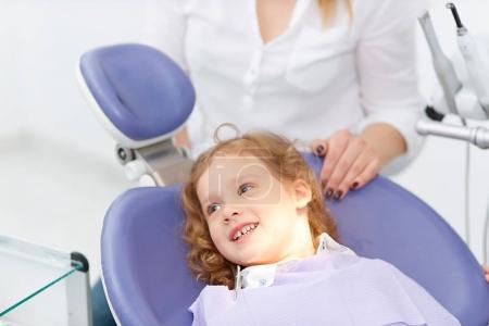 Little girl in dentist chair