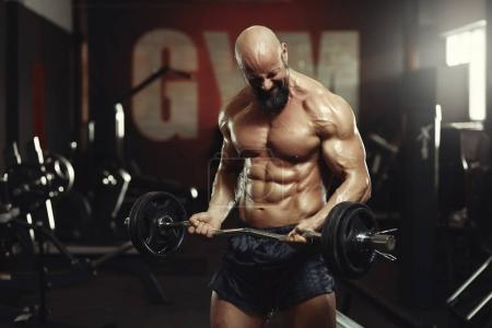 Mature sportsman exercising at the gym