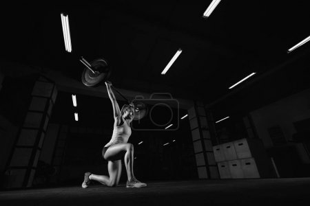 Photo for Low angle shot of an athletic young woman performing lunges with a barbell at the gym copyspace butt buttocks workout weightlifting WOD fitness sportspeople living leisure. - Royalty Free Image