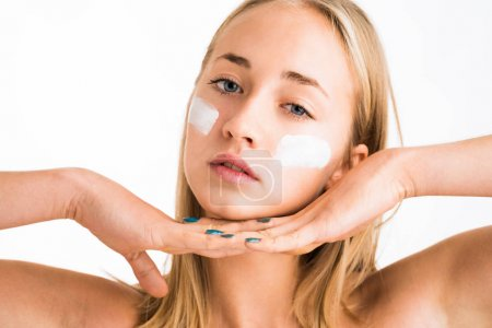 Girl using care skin products on face