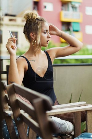 Stylish girl posing with cigarette