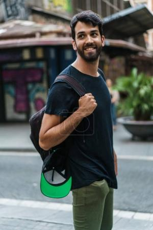 Man with backpack on street