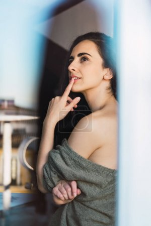 Young thoughtful woman posing romantically