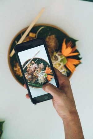 Photo for Unrecognizable person taking shot of plate with food in Bangkok, Thailand. - Royalty Free Image