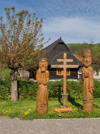 Religious wooden statues of Cyril and Methodius with the Double Slovak Cross.