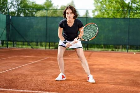 Beautiful young girl on the open tennis court