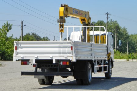 White Isuzu flatbed truck with