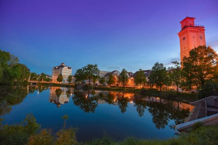 Altenburg Germany -May 2018: the little pond and arttower in front of the blue summer sky Kunstturm