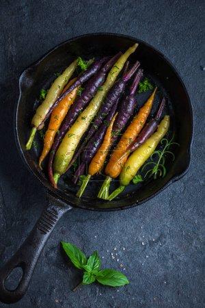roasted  rainbow carrots on pan