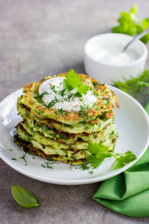 zucchini fritters, vegetarian zucchini pancakes, served with fr
