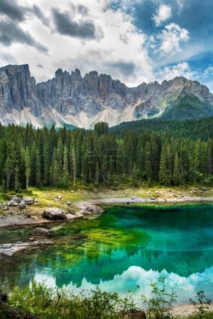 Carezza lake (Lago di Carezza, Karersee) in Dolomites Alps. Sout