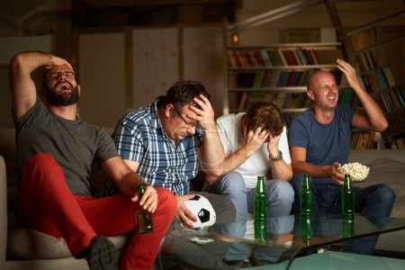 men watching soccer