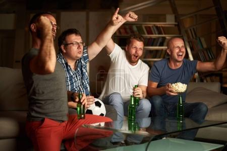 men watching soccer