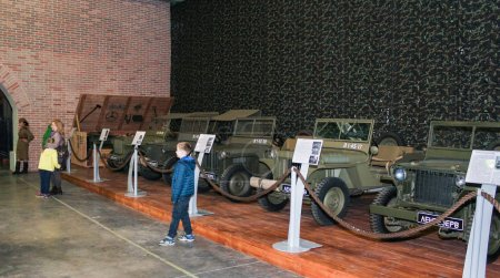 A number of army jeeps.