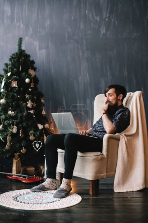 Hipster surfing the web.