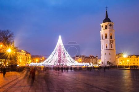 VILNIUS, LITHUANIA - DECEMBER 31 2017: night view of the christmas tree on central square, belfry and Cathedral of St. Stanislaus and St. Vladislav on the new years eve.