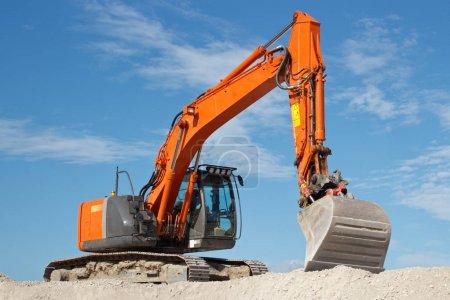 Excavator in gravel quarry site