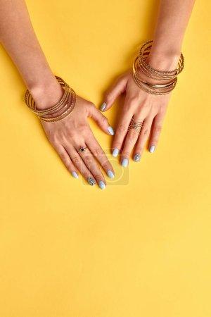 Fashionable summer manicure with imitation jewelery.