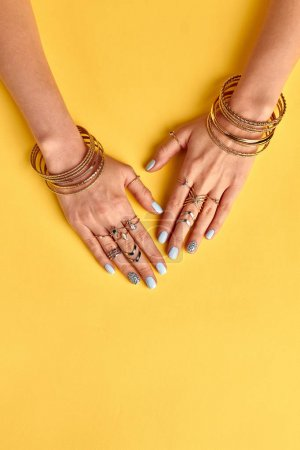 Beautiful summer gold bijouterie on female hands.