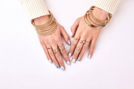 Beautiful female hands in jewelry.