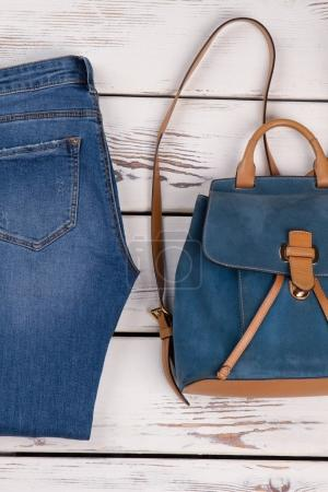 Women's jeans and leather backpack