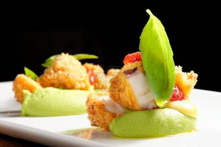 Photo for Fine dining, Fried Octopus on basil mousse and fresh strawberries - Royalty Free Image
