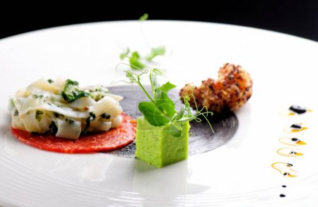 Photo for Haute cuisine, Gourmet appetizer, squid, shrimp tempura and Chorizo - Royalty Free Image