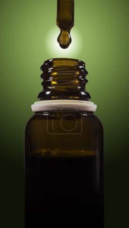 Photo for Cannabis oil being droped into a bottle. - Royalty Free Image