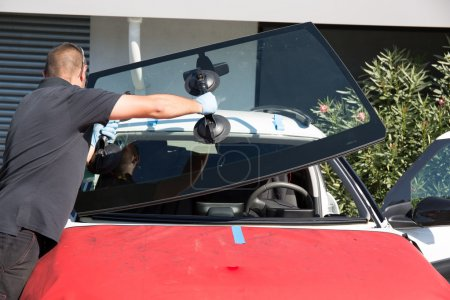 Photo for Windshield replacement, man is changing windscrenn on a car - Royalty Free Image