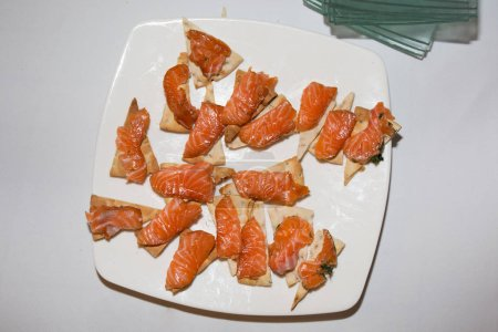 salmons with piece of bread for snack or appetizer